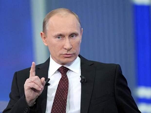 Путин вспомнил о карикатурах на себя с клыками и стекающей с них кровью