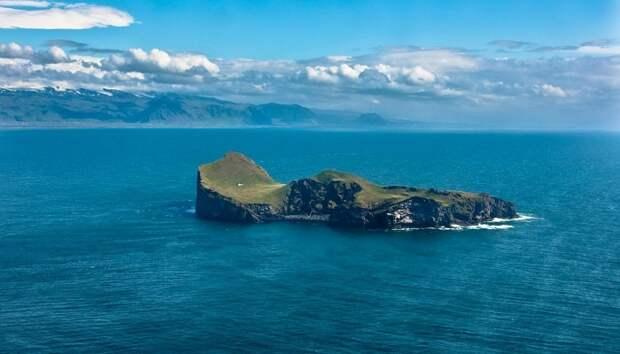 Добраться до одинокого острова Эдлидаэй не так-то просто (Vestmannaeyjar, Исландия).   Фото: facebook.com/ Nordic Travel.
