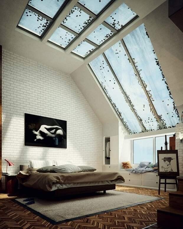 Пространство спальной задано с помощью размещения в ней крутого и большого мансардного окна, что добавляет освещения комнате.