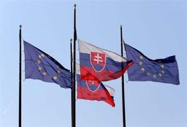 European Union and Slovakian flags are seen outside the Bratislava Castle (Hrad) in Bratislava, Slovakia, September 15, 2016. REUTERS/Yves Herman