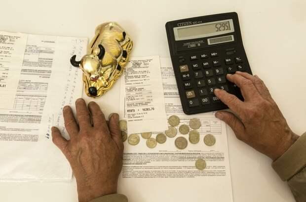 Путин подписал закон о долгах по ЖКХ