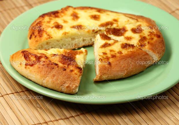 http://st.depositphotos.com/2765196/3706/i/950/depositphotos_37060503-Armenian-cheese-pie-khachapuri.jpg