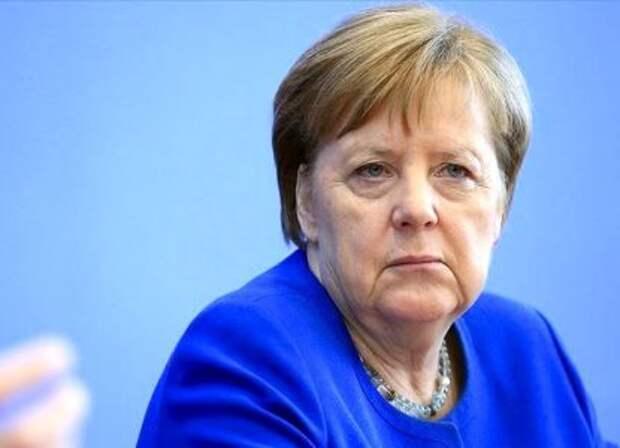 Меркель села на геополитический «шпагат»
