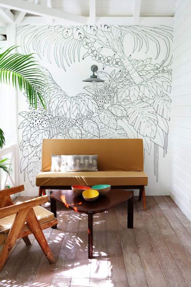 Зона отдыха с легким тропическим декорированием стен