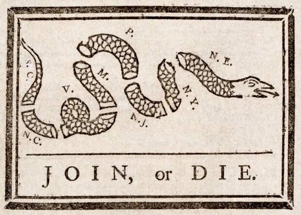 Вот такой был сначала флаг у США. Почему там была змея?