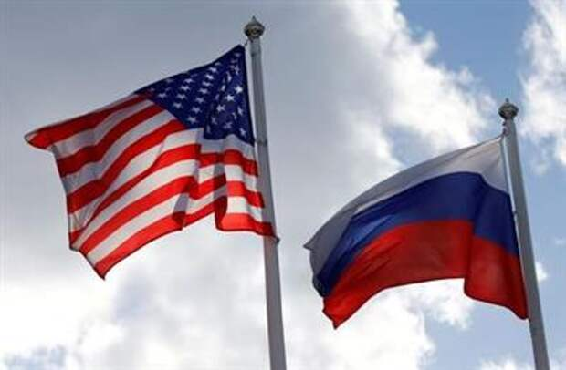 FILE PHOTO: Russian and U.S. state flags fly near a factory in Vsevolozhsk, Leningrad Region, Russia March 27, 2019. REUTERS/Anton Vaganov/File Photo/File Photo