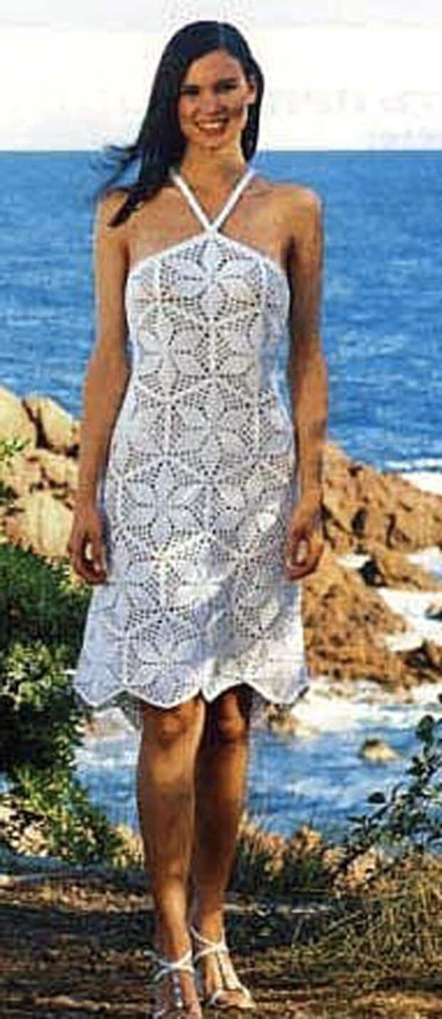 Необыкновенное белое вязаное платье