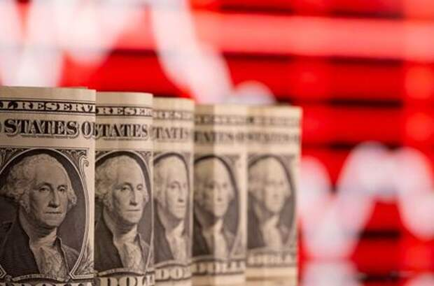 U.S. one dollar banknotes are seen in front of displayed stock graph in this illustration taken February 8, 2021. REUTERS/Dado Ruvic/Illustration