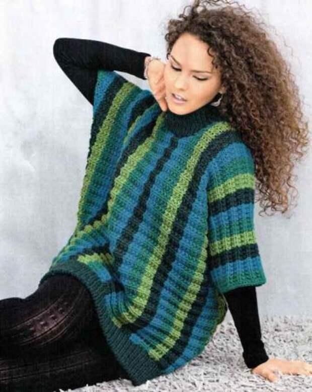 Зеленый пуловер связанный поперек