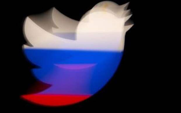 A 3d printed Twitter logo is pictured in front of a displayed Russian flag in this illustration taken March 10, 2021. REUTERS/Dado Ruvic/Illustration