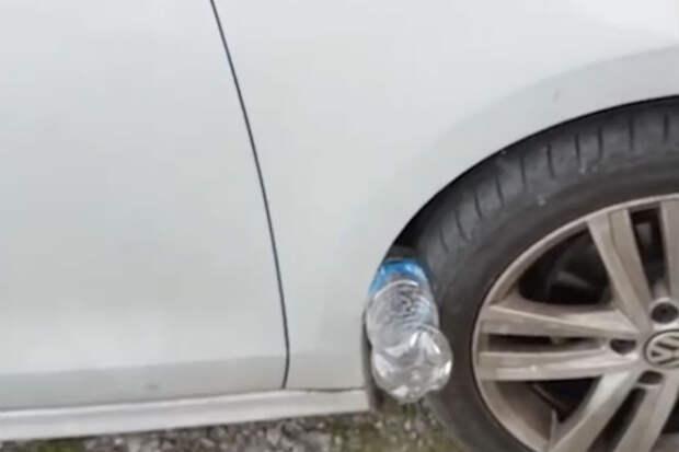 Бутылка в колесе машины: можно ли ехать дальше