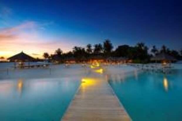 Объятия песка в Velassaru Maldives.