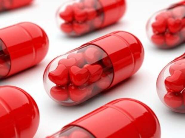 red pills filled with hearts in close-up view and depth of field