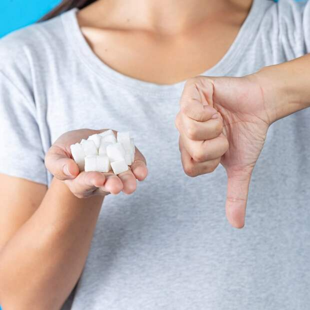 world-diabetes-day-hand-holding-sugar-cubes-thumb-down-another-hand