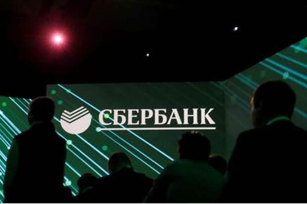 The logo of Russian bank Sberbank is seen on a screen during a session of the St. Petersburg International Economic Forum (SPIEF), Russia June 6, 2019. REUTERS/Maxim Shemetov