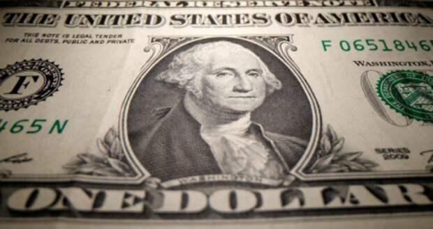 Банкнота номиналом один доллар США, 26 мая 2020 года. REUTERS/Dado Ruvic/Illustration