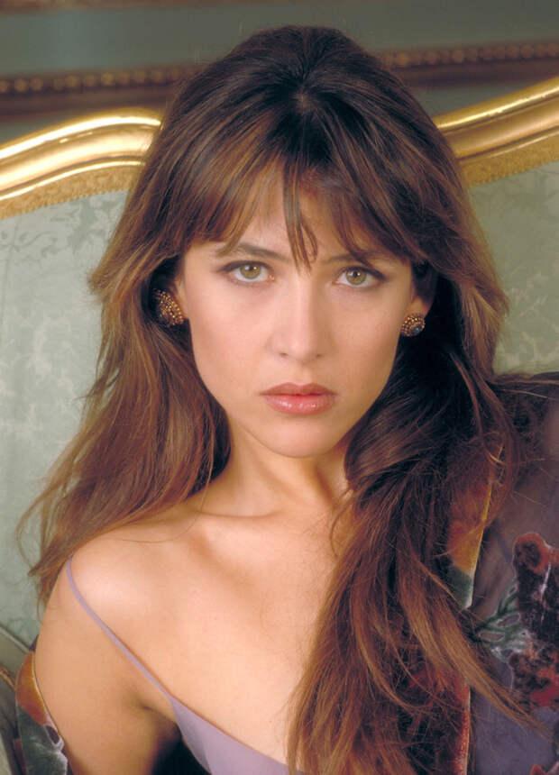 Софи Марсо (Sophie Marceau) в фотосессии для фильма «И целого мира мало» (The World Is Not Enough) (1999), фото 3