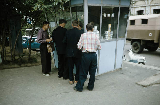 Russia, men purchasing from tobacco stand in Khabarovsk