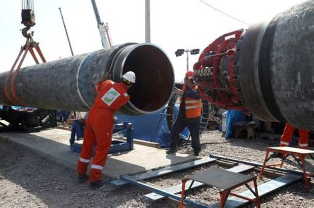 FILE PHOTO: Workers are seen at the construction site of the Nord Stream 2 gas pipeline, near the town of Kingisepp, Leningrad region, Russia, June 5, 2019. REUTERS/Anton Vaganov/File Photo