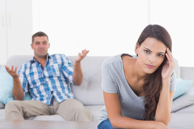 couple-fighting-angry-couch