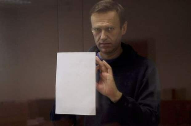 Kremlin critic Alexei Navalny, who is accused of slandering a Russian World War Two veteran, is seen inside a defendant dock during a court hearing in Moscow, Russia, Russia February 16, 2021, in this still image taken from video. Press Service of Babushkinsky District Court of Moscow/Handout via REUTERS ATTENTION EDITORS - THIS IMAGE HAS BEEN SUPPLIED BY A THIRD PARTY. NO RESALES. NO ARCHIVES. MANDATORY CREDIT. THIS IMAGE WAS PROCESSED BY REUTERS TO ENHANCE QUALITY, AN UNPROCESSED VERSION HAS BEEN PROVIDED SEPARATELY.