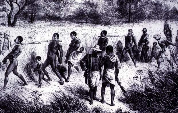 Группа связанных рабов под охраной вооруженных работорговцев (Центральная Африка, 1865 год)
