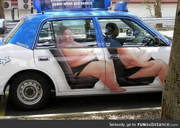 I'd love to ride this Sumo Taxi!
