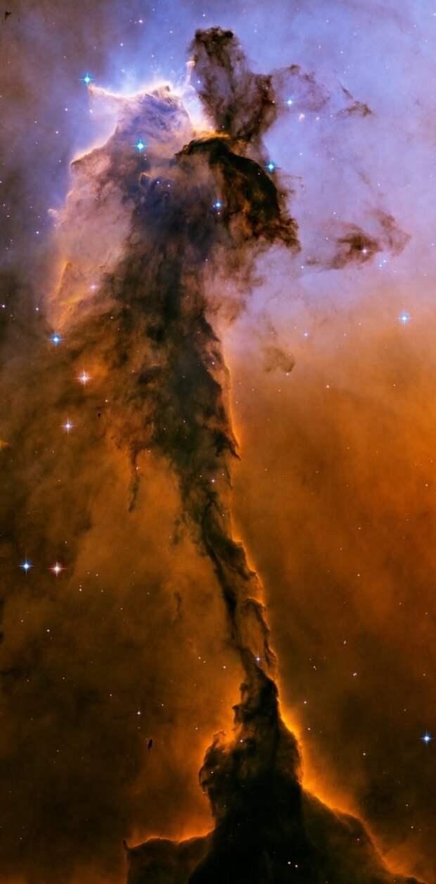 Это облако замерзшего газа и скосмической пыли в созвездии Орла насчитывает в высоту почти десять световых лет ТУМАННОСТИ, звезды, космический телескоп, космос, необычно, планеты, снимки, фото