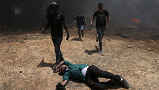 Столкновения палестинцев и израильских военных на границе сектора Газа с Израилем. 14 мая 2018