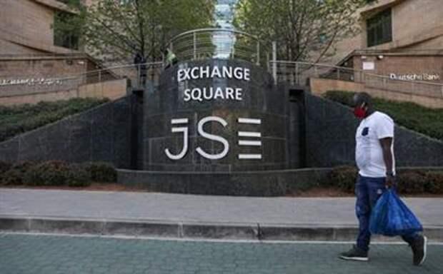 A man walks past the Johannesburg Stock Exchange (JSE), as the coronavirus disease (COVID-19) lockdown regulations are eased in Sandton, South Africa, September 10, 2020. REUTERS/Siphiwe Sibeko