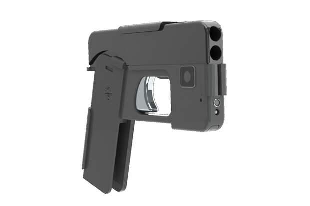 Пистолет маскируется подсмартфон