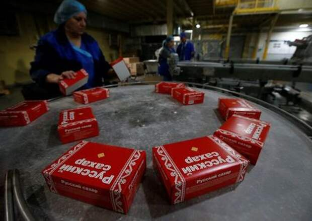 An employee sorts packages with refined sugar at Znamensky Sugar Plant, owned by Russian farming conglomerate Rusagro (Ros Agro Plc), in the settlement of Znamenka, in Tambov region, Russia October 13, 2017. Picture taken October 13, 2017. REUTERS/Sergei Karpukhin
