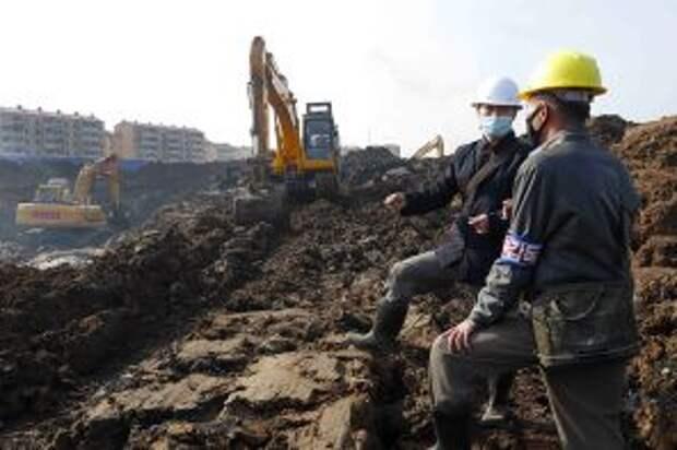 На фото: строительство новых жилых домов в районах Сонсин и Сонхва на юго-востоке Пхеньяна