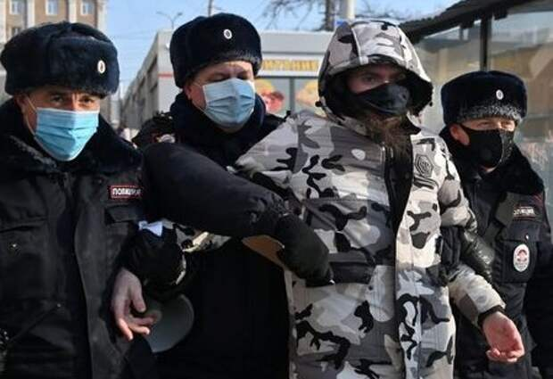 A protester is taken away by law enforcement officers during a rally in support of jailed Russian opposition leader Alexei Navalny in Omsk, Russia January 23, 2021. REUTERS/Alexey Malgavko