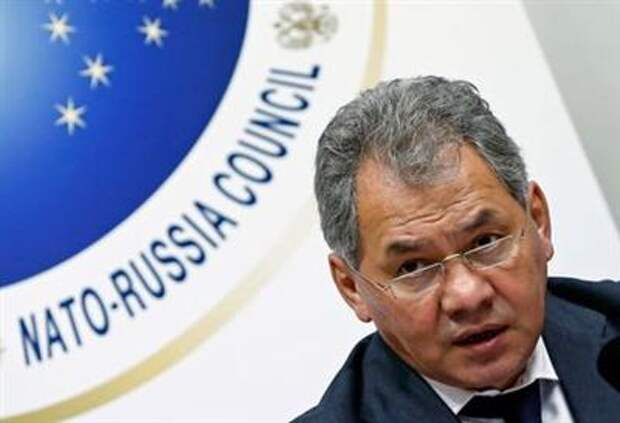 Russia's Defence Minister Sergey Shoygu holds a news conference at the end of a NATO-Russia defence ministers Council at the Alliance headquarters in Brussels October 23, 2013. REUTERS/Yves Herman (BELGIUM - Tags: POLITICS MILITARY)