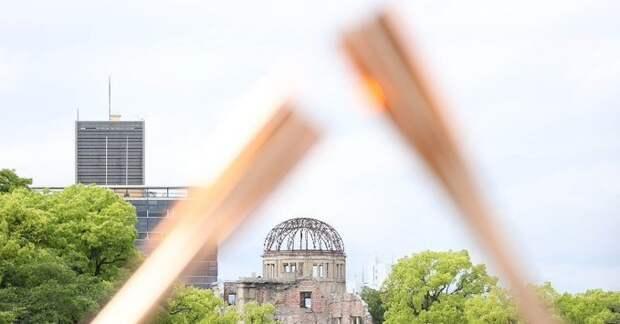 Эстафета олимпийского огня прошла вХиросиме взакрытом режиме