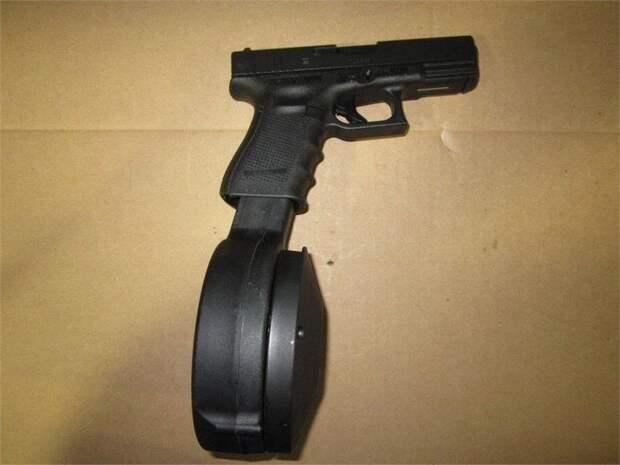Пистолет с барабанным магазином