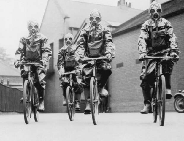 Cyclists of the London police unit wearing gas masks