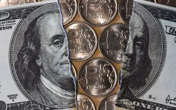 Эксперт: Преградой для снижения пары доллар-рубль по-прежнему выступает отметка 73