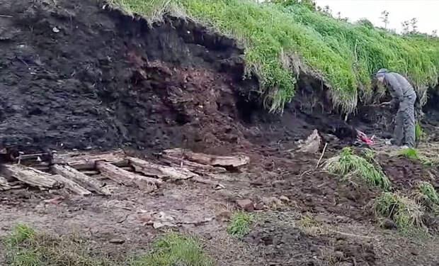 Пятиметровый слой вечной мерзлоты растаял и обнажил остов древнего корабля: видео