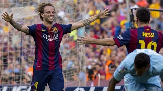 Иван Ракитич и Лионель Месси («Барселона») празднуют гол в ворота «Гранады»
